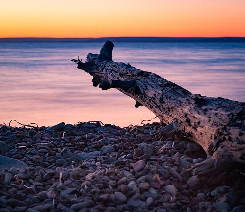 ca sunset lake canada beach log highway rocks novascotia capebreton brasdor castlebay capebretonisland brasdorlake irishcove benacadie novascotiatrunk4