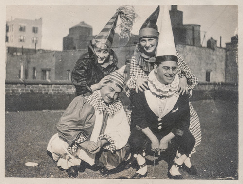 Two men and two women in clown costumes