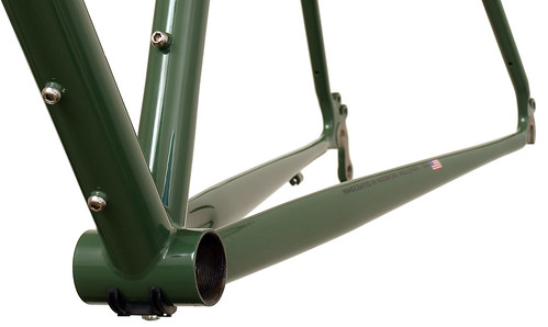 <p>Gunnar Grand Tour in Monetary Decals with Panda Panels.  The Grand Tour supports loading touring like nobody else.  Commuters will find the generous weelbase and stable handling a pleasure to ride, as well.  This chainstay view shows of the extra water bottel bosses tucked under the downtube.</p>