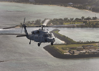 An MH-60S Seahawk helicopter is pictured during a photo exercise off the coast of Guam. | by Official U.S. Navy Imagery