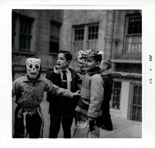 Little boys in Halloween costumes