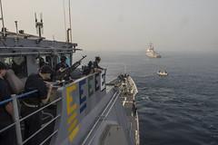 USS Antietam (CG 54) anchors next to USS McCampbell (DDG 85) during India's International Fleet Review. (U.S. Navy/MC3 David Flewellyn)