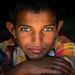 Iran, Central County, Kerman, gypsy boy with beautiful eyes by Eric Lafforgue