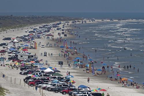 newsmyrnabeach beach ocean sea florida y6a2497dxo shore cars allrightsreserved copyright2016davidcstephens dxoopticspro1054 getty atlanticocean sand traffic crowd handheld