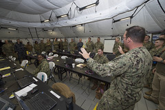 Cmdr. Jetter Riggs, assigned to Commander Task Force (CTF) 75, briefs Vice Adm. Joseph Aucoin, commander of U.S. 7th Fleet, during a tour of CTF 75's command tent during exercise Foal Eagle in March. (U.S. Navy/MCC Lowell Whitman)