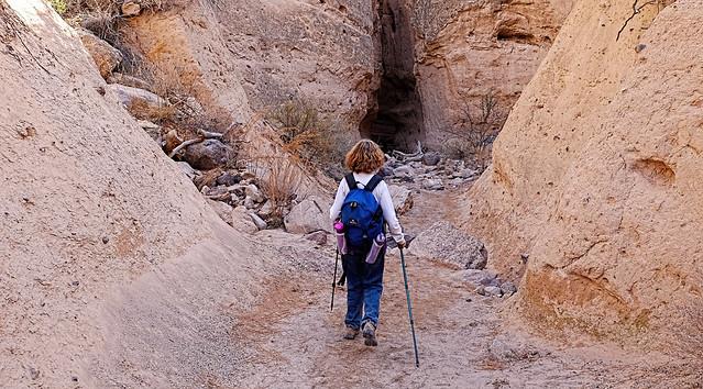 Tent Rocks hiker approaching the slot canyon