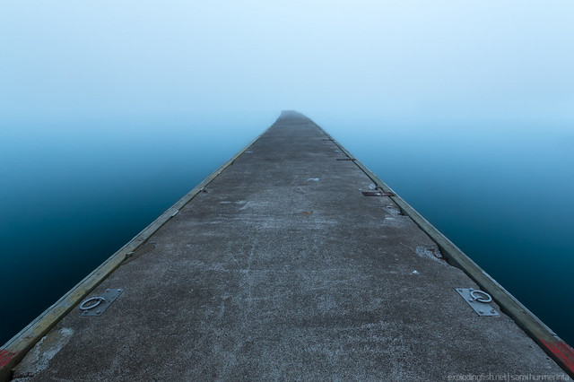 An empty pier on a foggy morning in Mariehamn