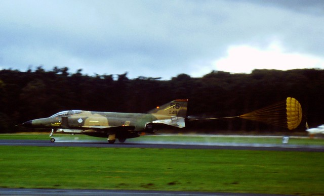 F-4E Phantom-II 68-0411/RS 526th TFS/ 86th TFW USAFE. With deployed brake-chute on a wet runway at Soesterberg Air Base, Wednesday 16 October 1985. (Ten years later it crashed in New Mexico).