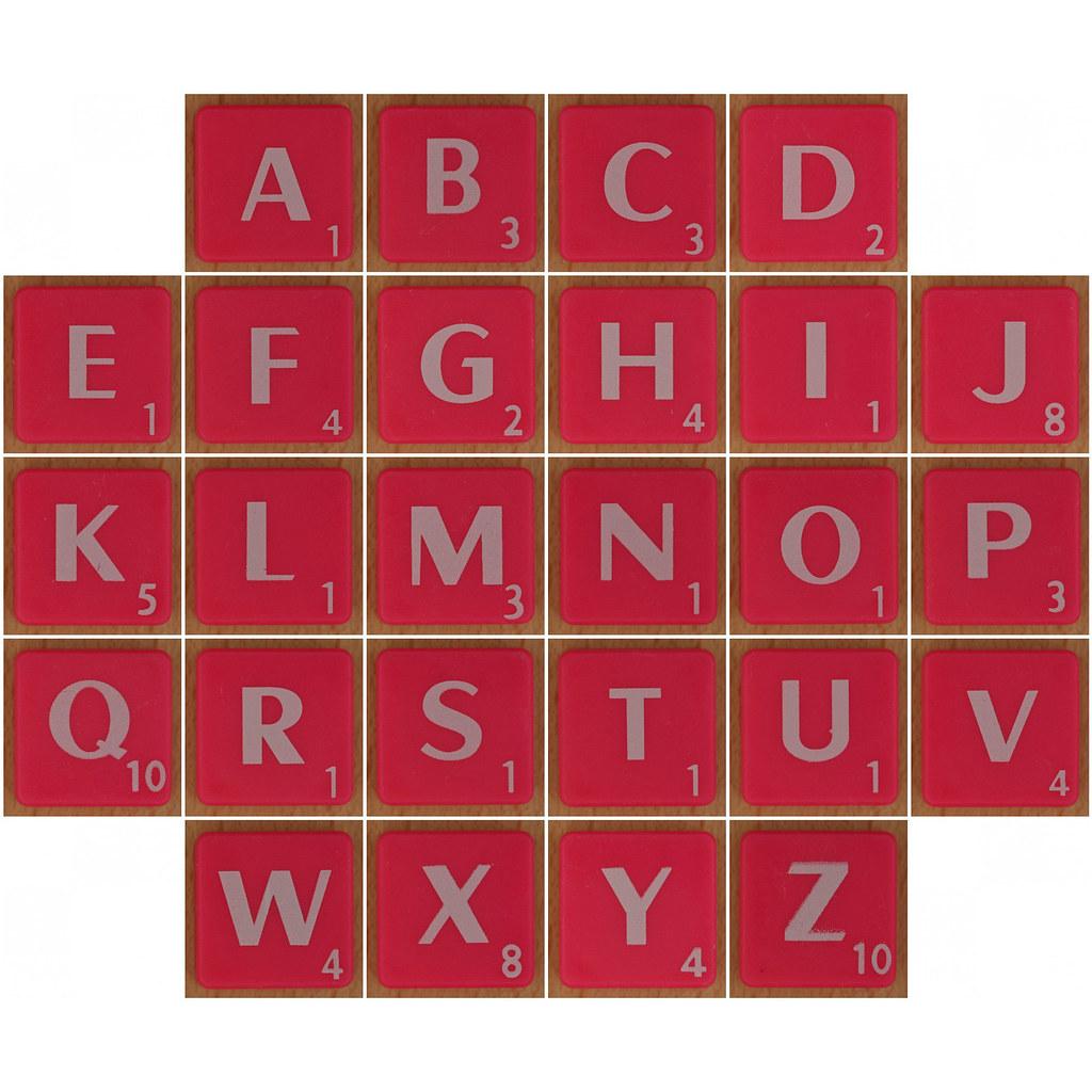 Scrabble white letter on hot pink alphabet