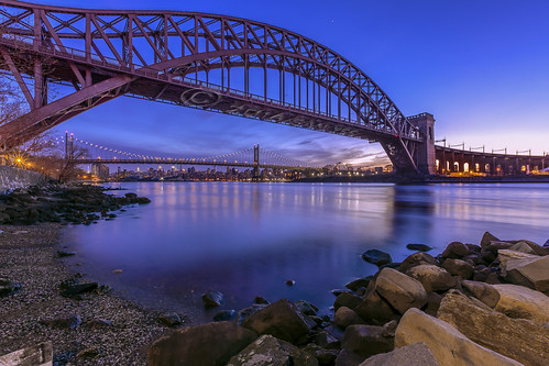 nyc longexposure railroad sunset night island arch nightscape dusk perspective queens shore eastriver astoria blueskies bluehour railroadbridge wards rfk hellgatebridge hellgate triboroughbridge ultrawideangle clearnight steelarchbridge ef1635mmf28liiusm througharchbridge canon5d3 strykapose nyconnecting waysreef