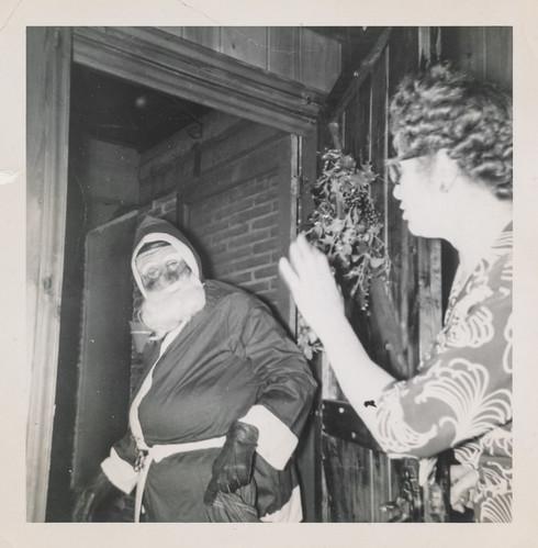 Santa Claus visiting a woman