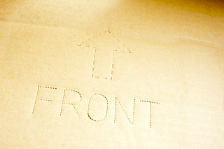 The word front punched into corrugated cardboard