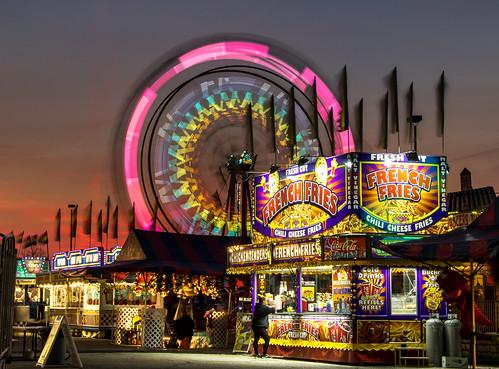 longexposure carnival sunset sky lights ride michigan fair flags april ferriswheel wyoming vender 2016 westmichigan kentcounty canon7dmarkii