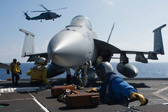 Sailors aboard USS John C. Stennis (CVN 74) move an F/A-18E Super Hornet aboard the aircraft carrier earlier this week. (U.S. Navy/MC3 Kenneth Rodriguez Santiago )