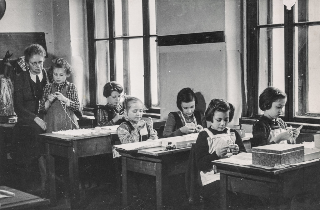 School girls knitting in class