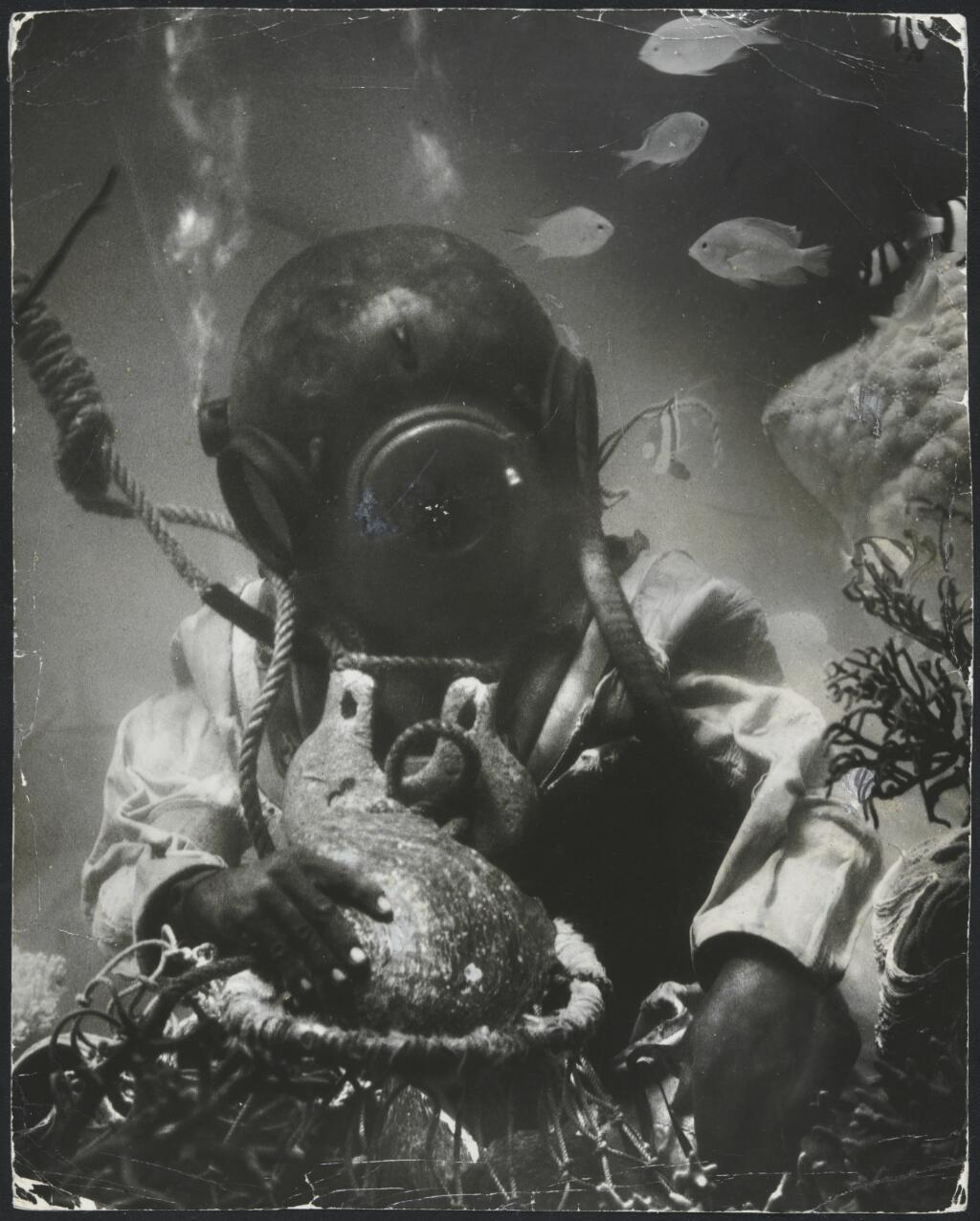 Pearl diver collecting shells from the beds of Torres Strait, Queensland / Frank Hurley