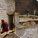 Young novice playing on the roof of Phuktal monastery, Zanskar by magbrinik