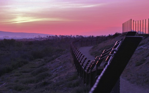 sunset fence trails bluehour pinksky bolsachicawetlands purplelight walkingbolsachica janeelizabethlazarz