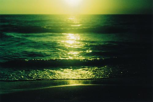 ocean light sunset sea sun green film beach yellow analog 35mm xpro crossprocessed sand magic horizon wave depthoffield naples dreamy tungsten analogue canona1 fujichrome filmgrain fromthearchives 64iso tungsten64ttypeii