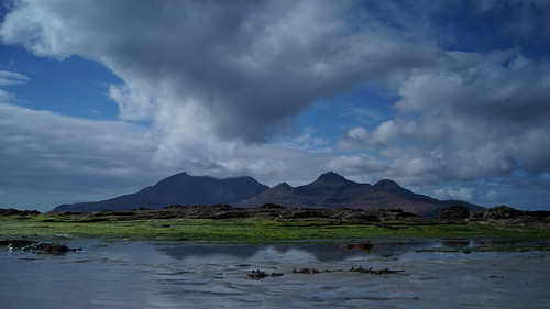 Dramatic clouds gathering over and reflecting the isle of rum, Inner Hebrides Scotland | by strangesimon