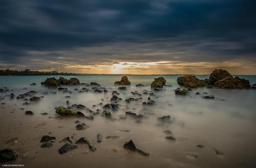 longexposure sunset clouds skyscape nikon rocks puertorico seashore
