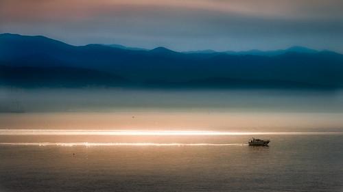 ocean light sea sky sun mountains reflection water silhouette backlight sunrise landscape boat seaside outdoor croatia shore adria kvarner