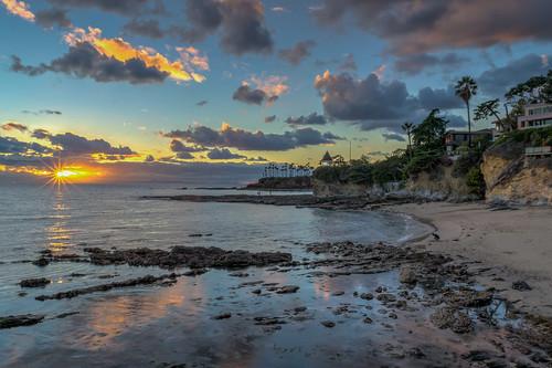 ocean california sunset sky cliff seascape reflection beach clouds reflections geotagged outdoors evening sand nikon rocks unitedstates cliffs palmtrees pacificocean palmtree serene lowtide hdr lagunabeach nikond5300