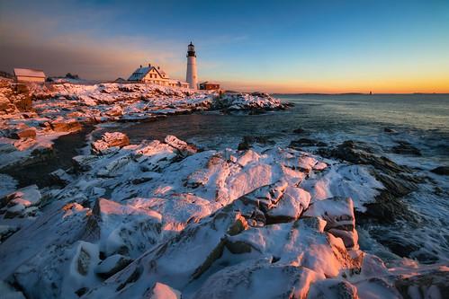 ocean winter sky lighthouse snow water sunrise maine newengland coastline portlandheadlight capeelizabeth fortwilliams fortwilliamspark robertallanclifford robertallancliffordcom