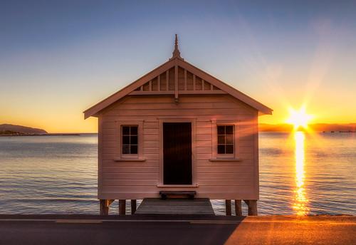 boathouse boatshed citylandscape coastline evening huttcity lowerhutt lowrybay nature newzealand northisland seafront seaside shore sunrays sunset sunshine waterfront wellington cityscape nz