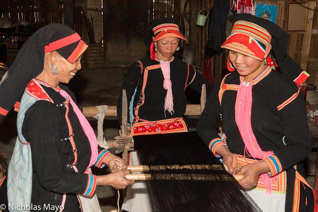 Black Dao Women Preparing Warp Thread