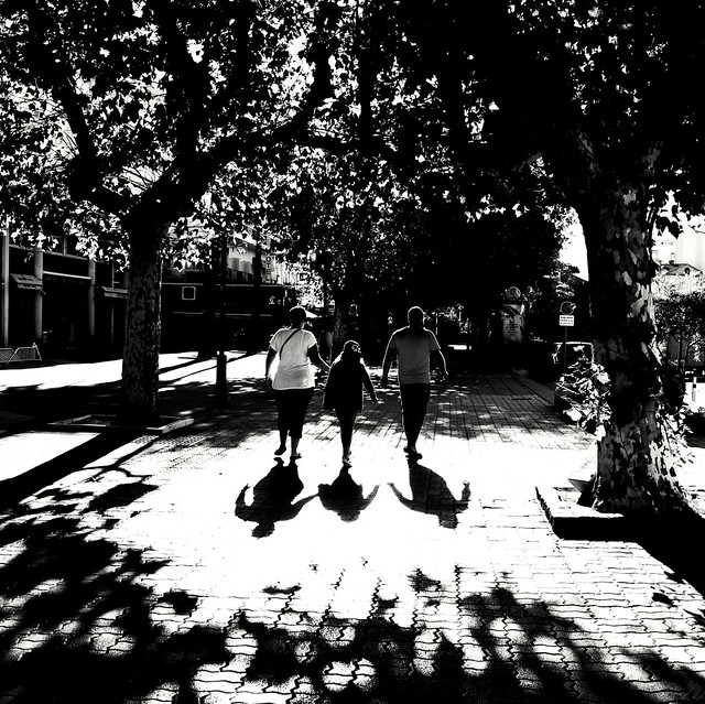 Family walk with shadows
