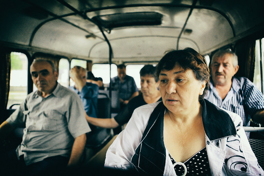 Workers in the bus on their way to the work (EMC)
