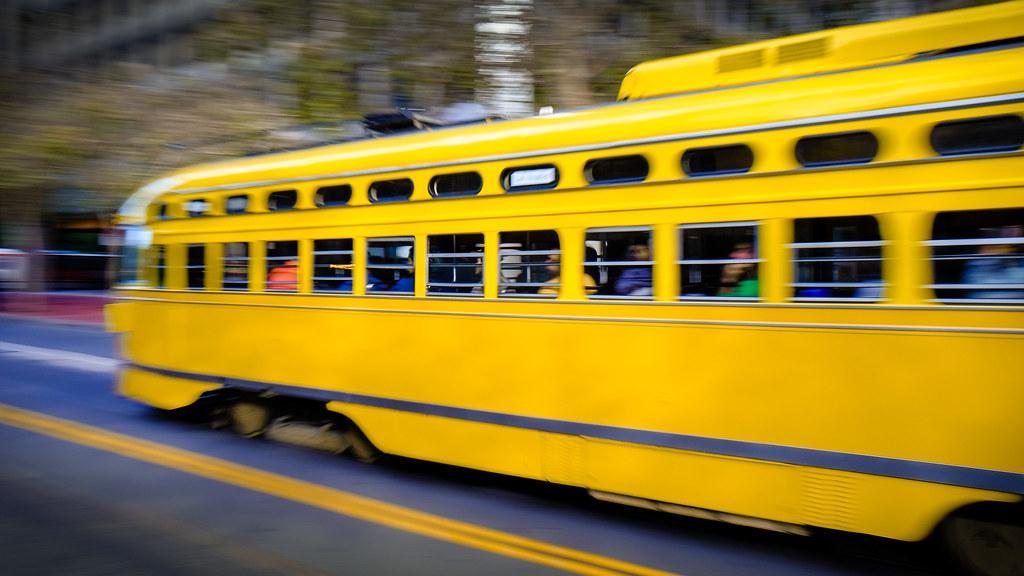 sitting in a yellow streetcar
