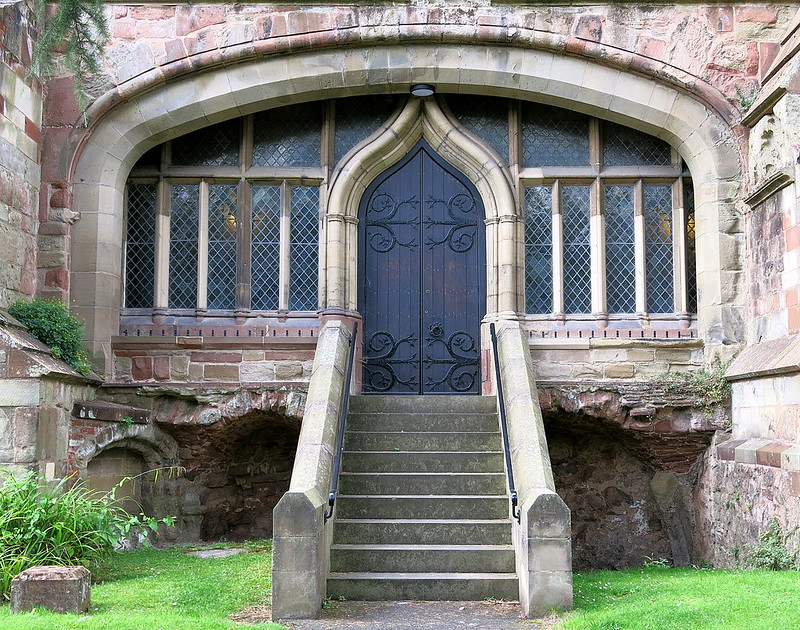 A doorway framed by windows, Great Malvern Priory, now the Parish Church of St.Mary and St.Michael, Great Malvern, Worcestershire, England
