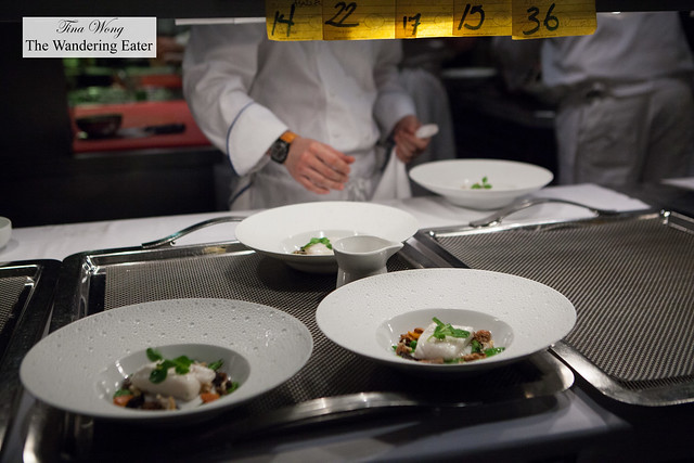 Plates of fish ready to be sent out to the dining room