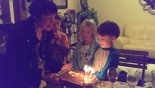 Mom presents the birthday cake | by Christopher.Johnson