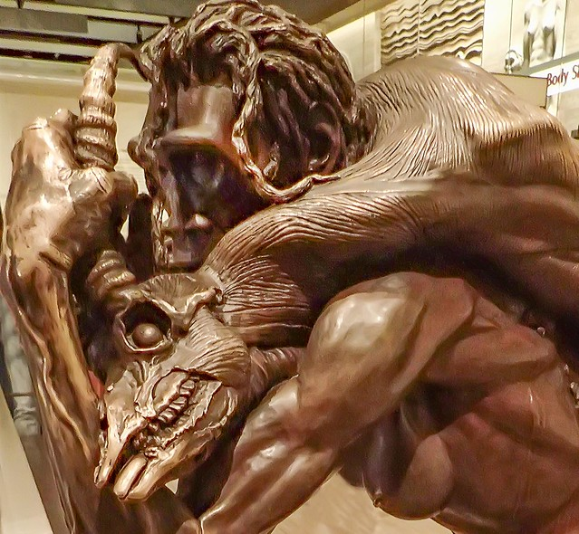 Bronze sculpture of a female Homo Erectus hunter with an antelope kill 1.89 million - 70000 B.P.