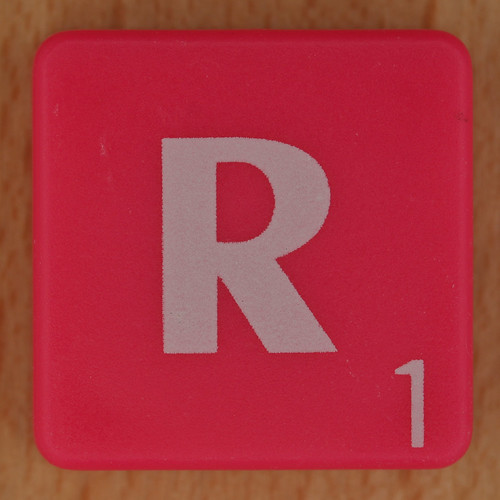 Scrabble white letter on hot pink R   by Leo Reynolds