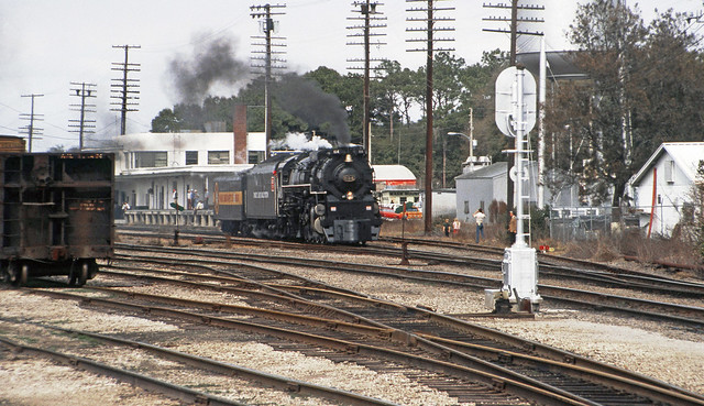 SCL / L&N Family Lines Rail System operated C&O LIMA 4-8-4 steam locomotive # 614, is returning to the Safety Express passenger train after maintenance, inspection & water replenishment was performed at the Amtrak Station in Wildwood, Florida, 2-1981 (12)