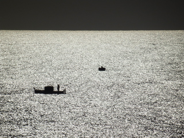 Boats on a sunlit sea