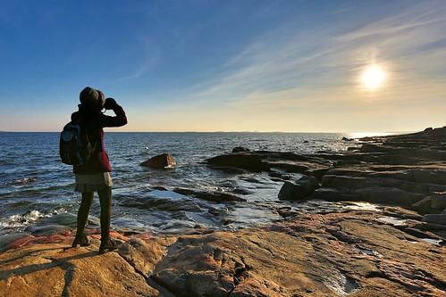 camera woman sun rock clouds suomi finland helsinki granite suomenlinna
