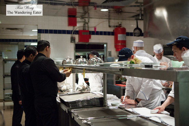 Waiters, cooks and chefs at the line