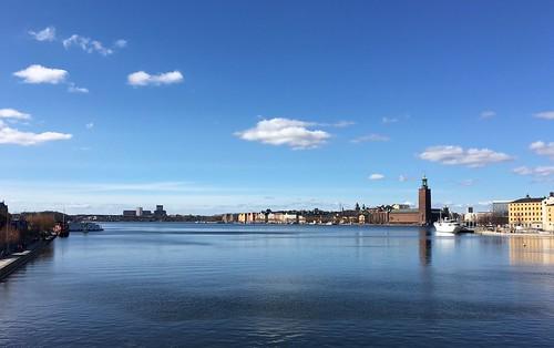 sky water landscape seaside waterfront sweden stockholm outdoor cityhall shore riddarfjärden stockholmsstadshus