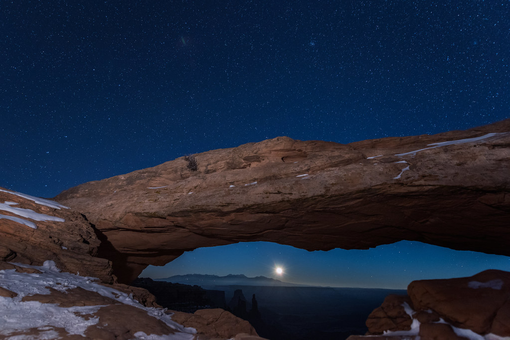Moonrise at exactly 12 midnight on New Year's Eve at Mesa Arch, Canyonlands National Park, Utah