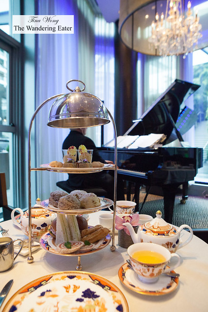 Afternoon tea spread and a live pianist playing in the background