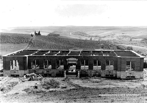 It's #ThrowbackThursday! Pictured is an undated photo of Troy Hall under construction. This hall used to house Ferdinand's Ice Cream Shoppe, where Cougar Cheese was invented. Photo courtesy #WSU News archives. #GoCougs #TBT