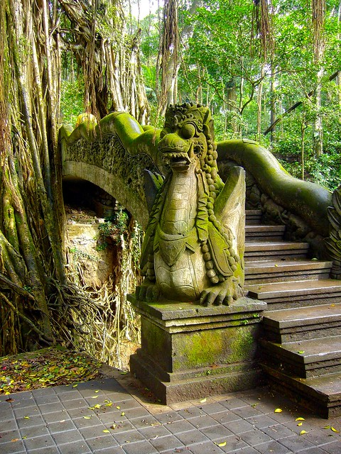 Bridge with dragon statue in the jungle on Bali, Indonesia