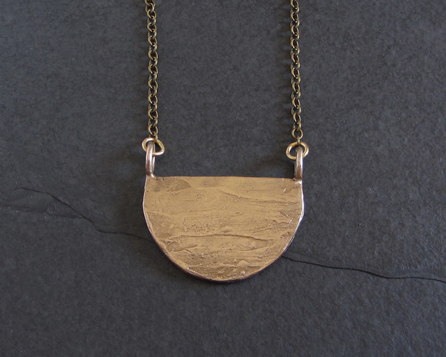 Rough textured bronze pendant