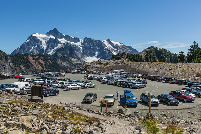Vehicles Parked at Artist Point Trailhead with Mount Shuksan Rising in the Distance