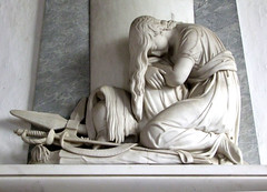 Grief weeping over weapons of war